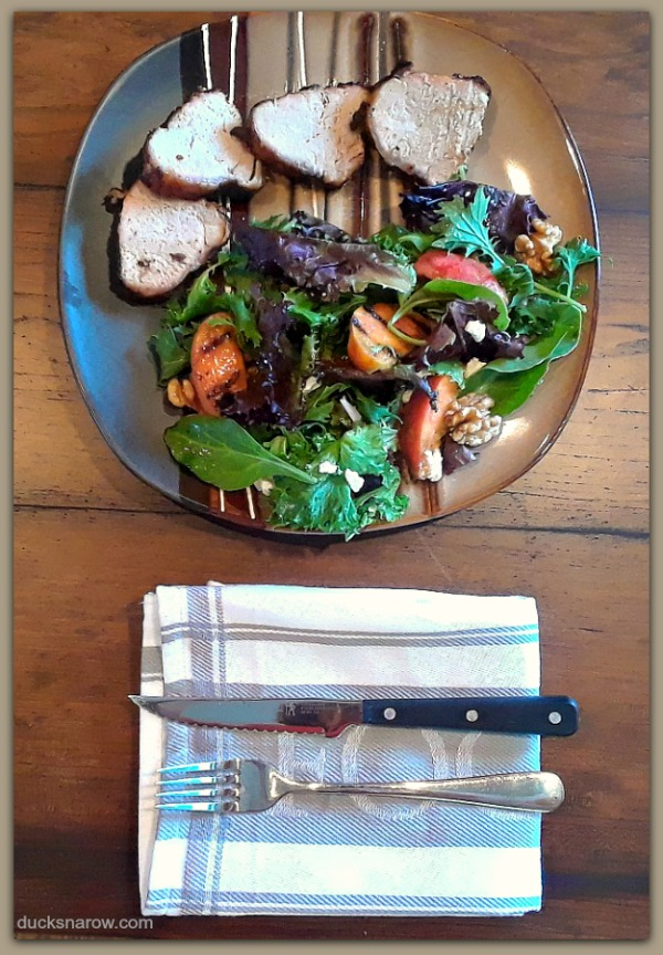 Delicious grilled Smithfield Marinated Fresh Pork loin with field green salad adorned with grilled peaches #ad #RealFlavorRealFast