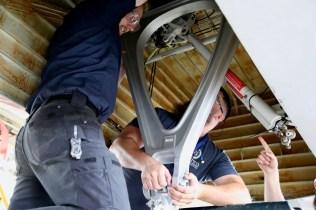AAR mechanics work on an aircraft