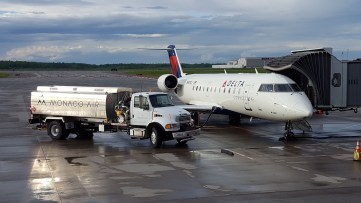 Monaco air provides fueling service to a commercial aircraft