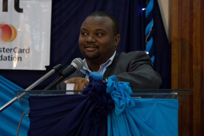 Samuel speaking at a conference