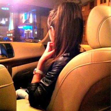A girl in car with hand on chin