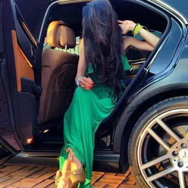 A girl with opening door of car