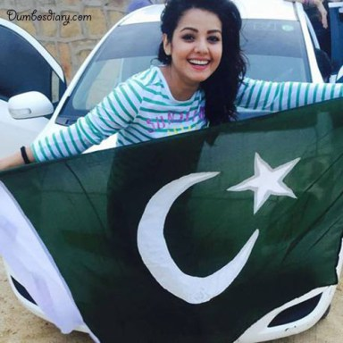A happy girl holding Pakistani Flag