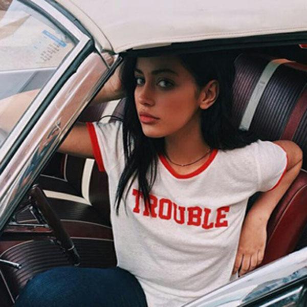 Beautiful girl posing in car