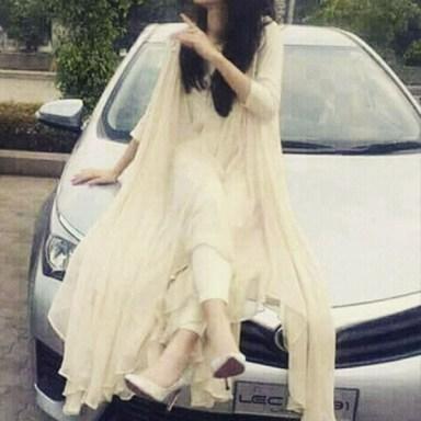 Beautiful girl sitting on car