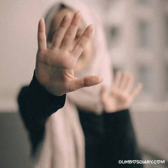 Innocent muslim girl hidding her face with hand