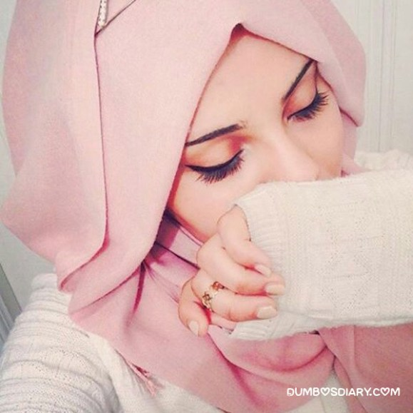 Innocent muslim girl in pink hijab