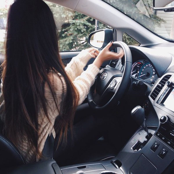 Long hair girl driving