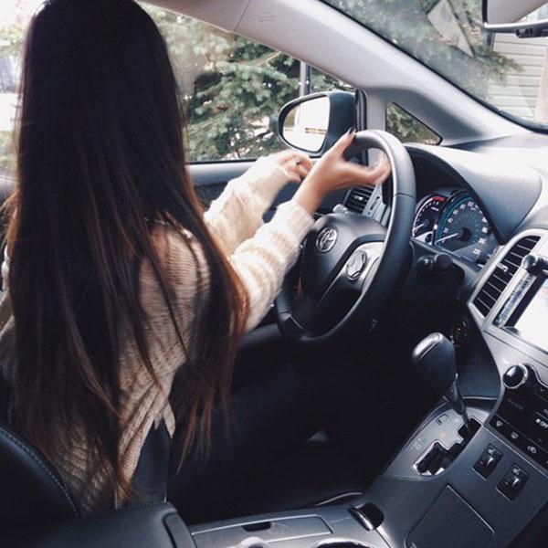 Long hair girl driving