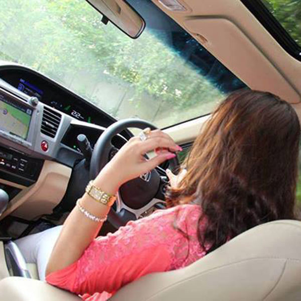 Pink shirt girl driving