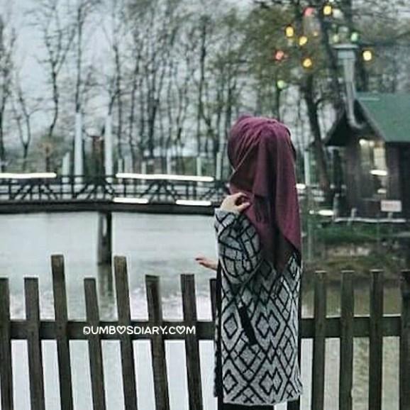 Pretty hijabi girl enjoying beautiful weather