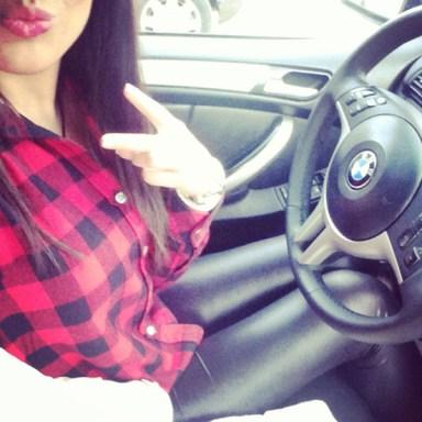 Red shirt girl in car taking selfie