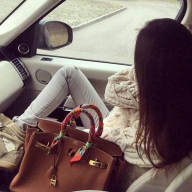 Sad girl sitting in car