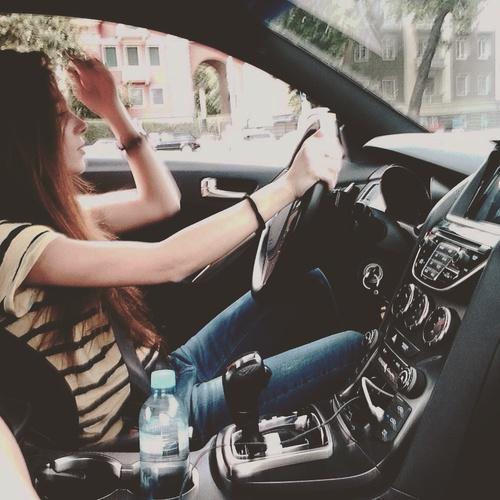 Stylish girl in smart car