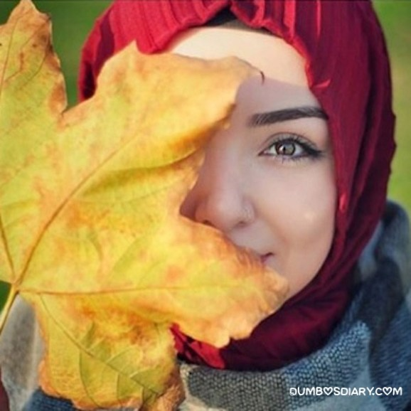 Yellow maple leaves muslim girl hidden face