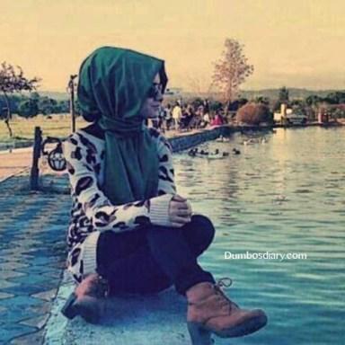 beautiful hijabi girl sitting on beach