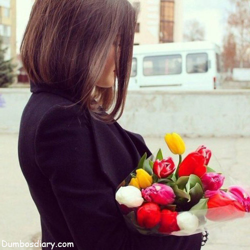 black dress girl with flowers