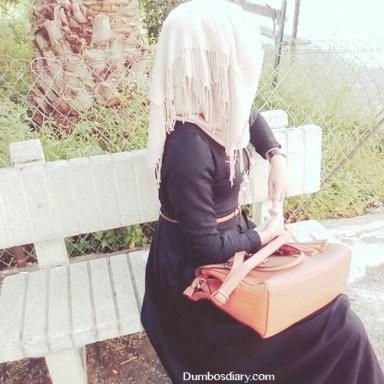 hijabi girl sitting in garden