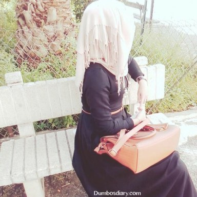 hijabi girl sitting in garden