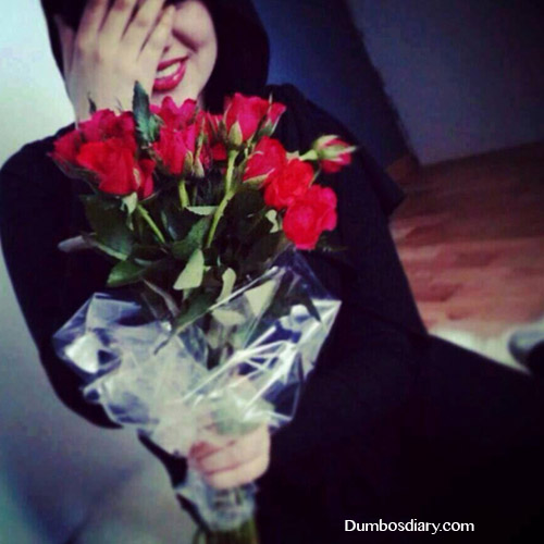 smiling muslim girl with flowers
