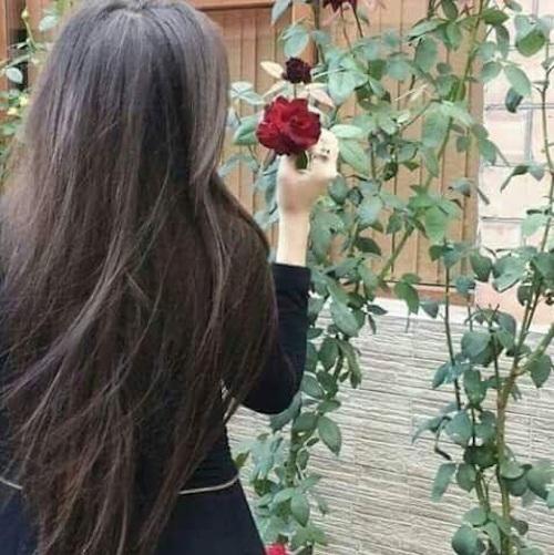 girl-plucking-flower-in-garden