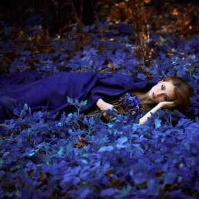 girl-lying-on-blue-flowers