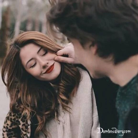 Boy cuddling girl cheeks