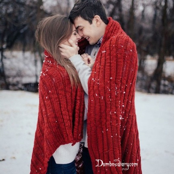Couple in red in snow