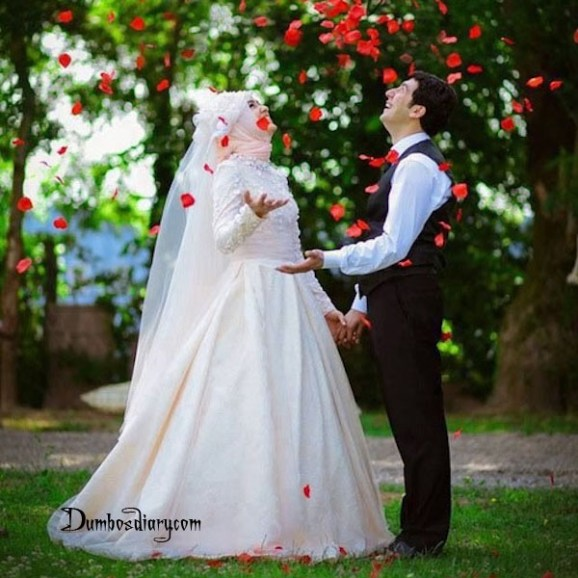Rose petals falling on wedding couple