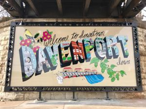 Welcome sign in Downtown Davenport, Iowa, illustrated by Johnnie Cluney