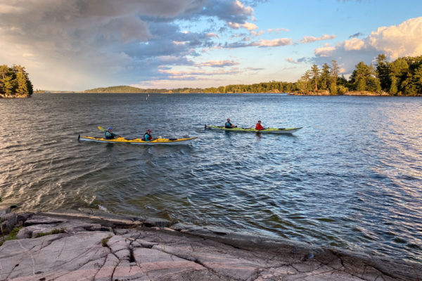 Kayakers observing island for sale