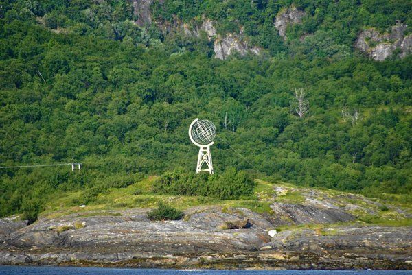 Arctic circle marker viewed from Kilboghavn to Jektvik ferry, on route 17, Nordland County, Norway