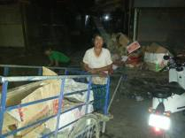 Working at night collecting rubbish to earn an income