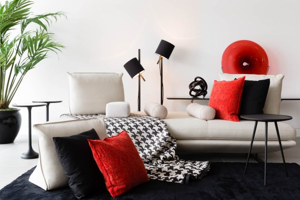 An interior product photograph styled first with red and then black props