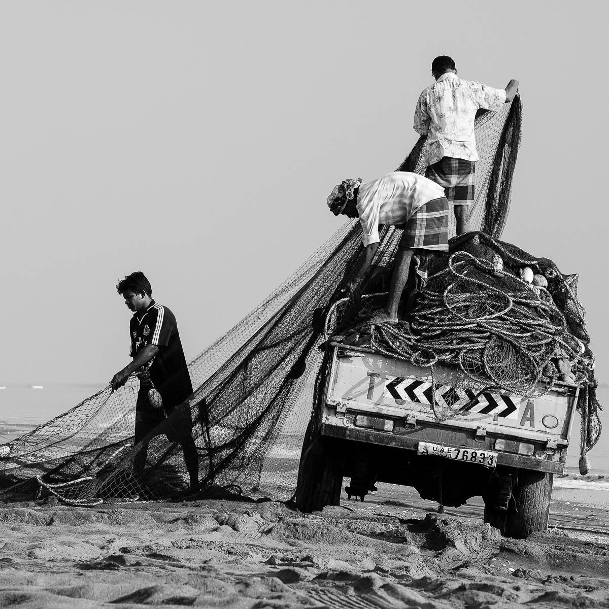 Fishermen prepare the nets at the beginning of the day. Khor Kalba, Sharjah, UAE