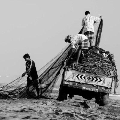 Fishermen prepare the nets at the beginning of the day. Khor Kalba, Sharjah, UAE