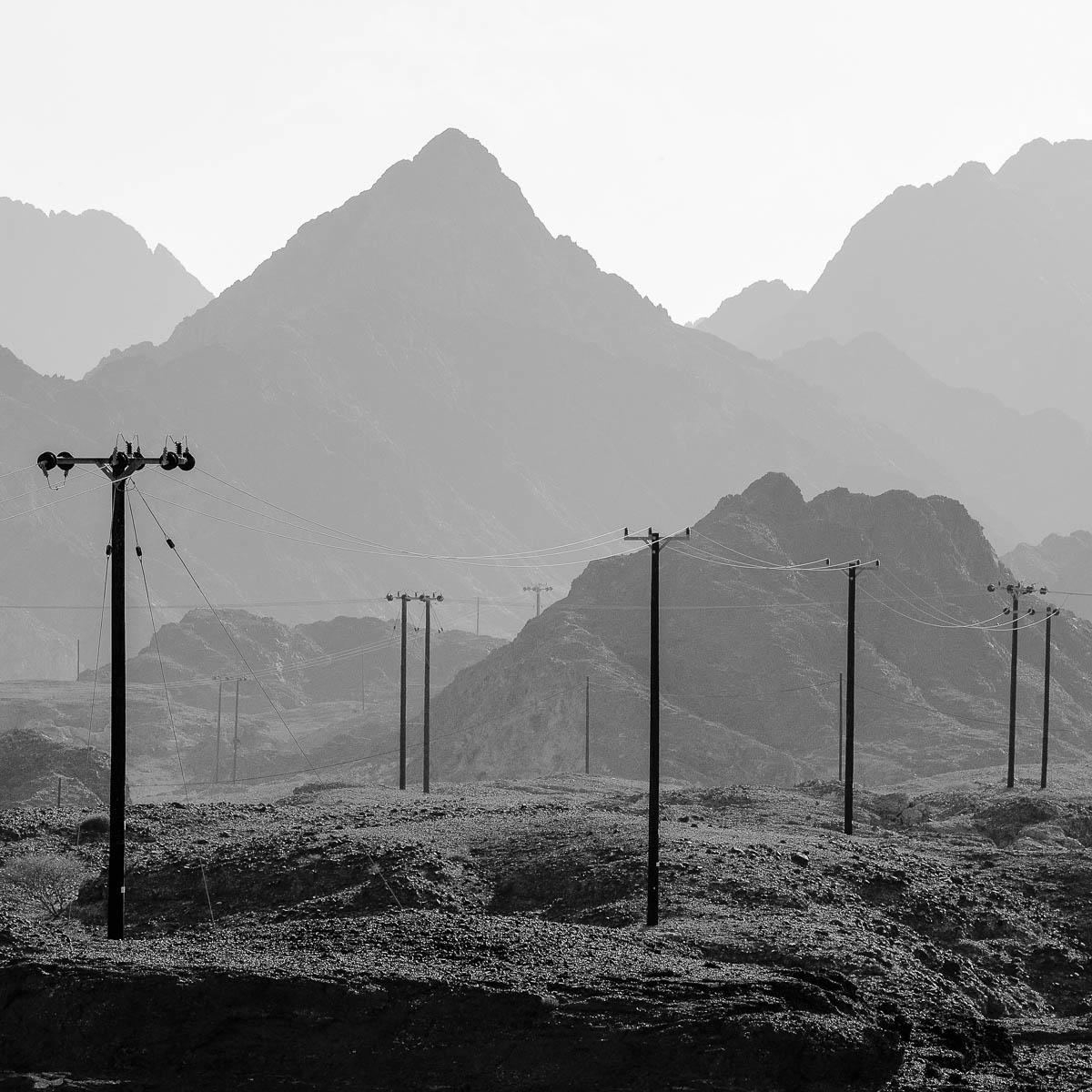 Powerlines traverse the remote Hajar Mountain region of Dubai, UAE