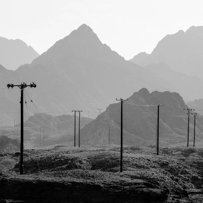 Powerlines traverse the remote Hajar Mountain region of Dubai, UAE