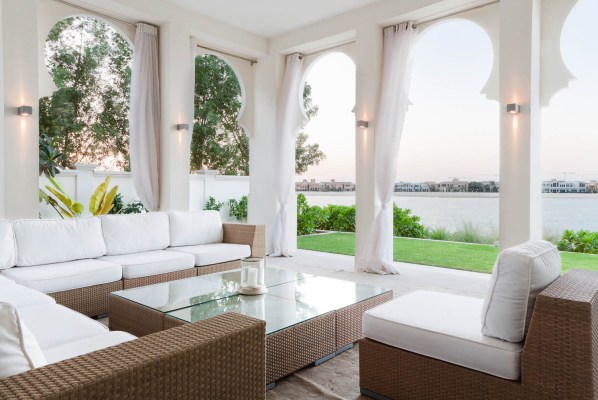 A photograph of the exterior seating area of a luxury villa on the Palm Jumeriah, Dubai
