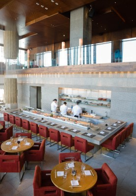 Interior Photograph looking down on the main dining area of Zuma restaurant, DIFC, Dubai