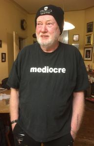 John Bulley wears his 'mediocre' tee shirt with pride
