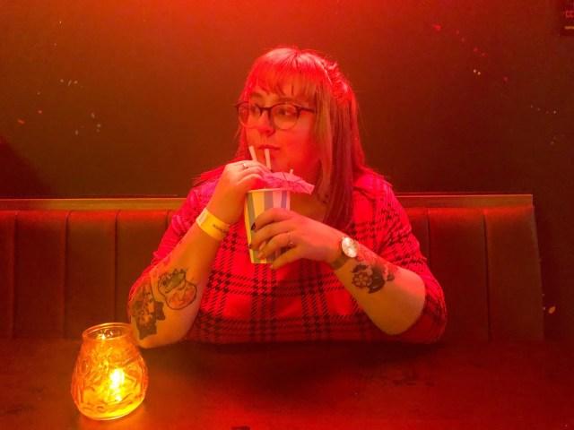 Dungarees & Donuts enjoying a drink.