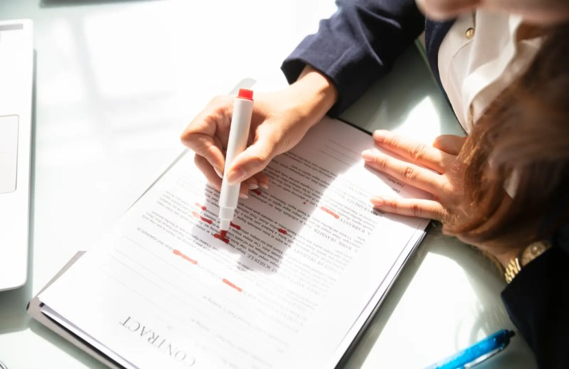 Contract Review Lawyer reviewing papers