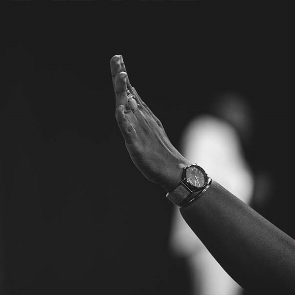 A worshipper's hands raised to Jesus at a ministration by Dunsin Oyekan