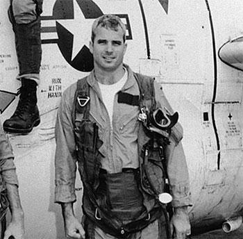 Lieutenant McCain standing by a T-2 Buckeye trainer, 1965