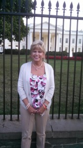 Janelle Barcelona, DuPage Pads Vice President, Development, in front of the White House.