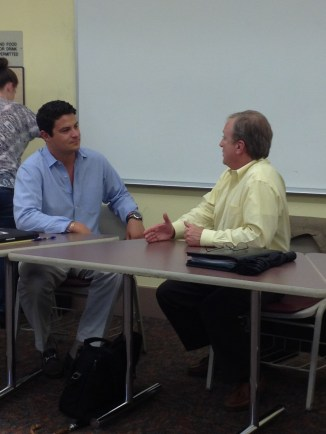 An evening MBA student, joins the sMBA class for a discussion with Mr. Buckley.