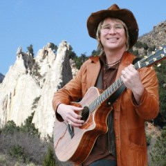 "JOHN DENVER inducted into the Colorado Music Hall of Fame, hosted by Olivia Newton-John, as Governor Hickenlooper declares ""Earth Day in Space."""