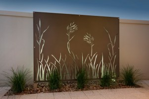 Organic patterns fit well within the landscape. A brick wall can act as a great canvas for metal wall art. Back light screens at night are bold and beautiful.