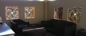 Cor-ten steel metal screens used as insets to allow for light and interest in this living space.